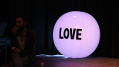 This image demonstrates that discreet backlighting behind this Love Ball helps get the message across.