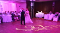 This image shows a lovely lighting effect for the wedding couple's first dance is to project a rotating custom monogram on the dance floor. Photo by Artistic Illumination.