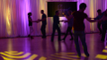 This image shows slowly moving floor patterns combined with soft shades in the backlighting combine to create a relaxing intimate environment for social dancing. Photo by Memories in Motion.