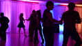 This image demonstrates skillful use of indirect lighting and colours creating the right ambience for a dance or party. Photo by Memories in Motion.