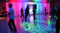 The image shows the artistic illumination created by constantly shifting backlighting of the drapes and slow moving highlights on the dance floor. Photo by Artistic Illumination.